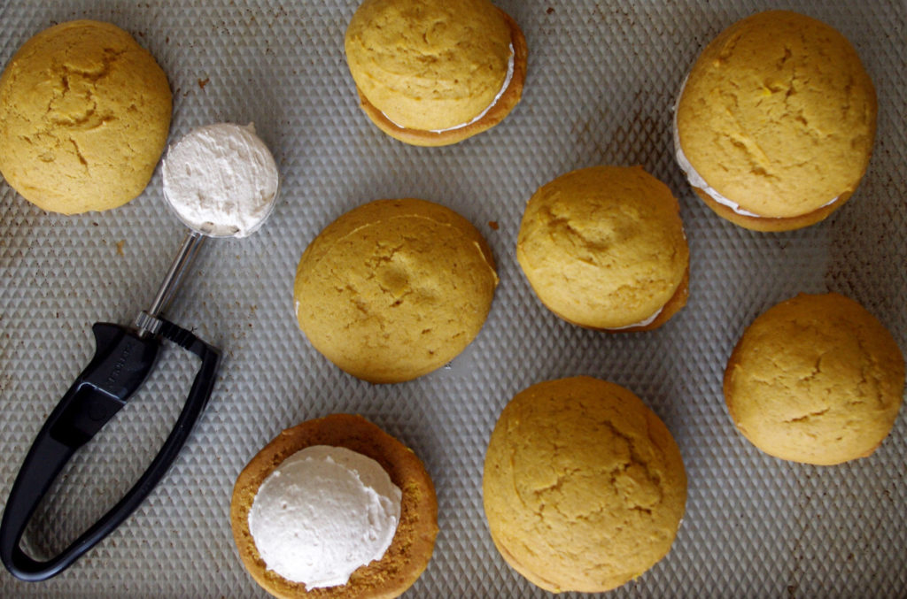 Pumpkin Whoopie Pies with Whipped Cinnamon Filling are soft, pillowy bundles of cinnamon sweetness and pumpkin goodness | www.thebatterthickens.com