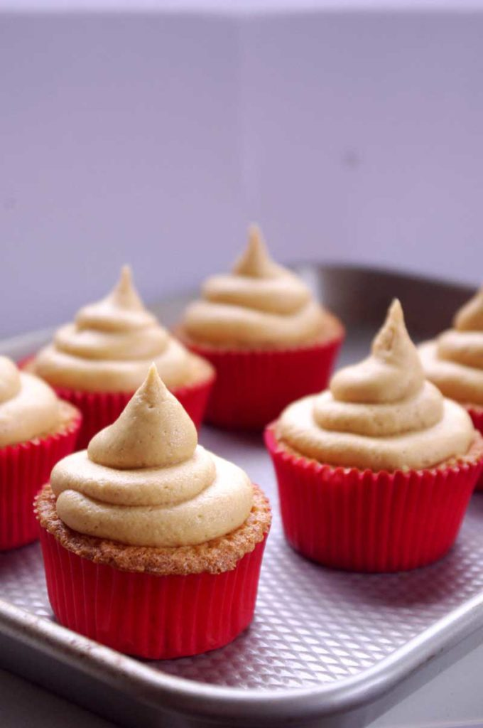 Ritz Cracker Cupcakes -- with peanut butter frosting and nutella filling, these cupcakes are your after school snack dreams brought to life   www.thebatterthickens.com
