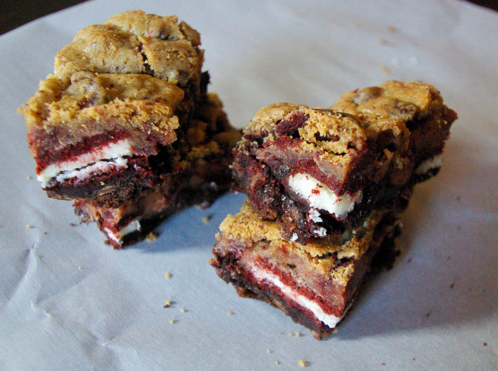 Red Velvet Oreo Cookie Brownie Bars | Crushed Red Velvet Oreos incorporated into cookie dough, then baked on top of Oreos and brownies to make some of the best bars ever.