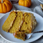 Pumpkin Spice Overdose Cake - 3 layers of soft pumpkin cake filled with pumpkin ganache and pumpkin salted caramel with pumpkin frosting and decorated with pumpkin whipped cream, aka ALL THE PUMPKIN! | www.thebatterthickens.com